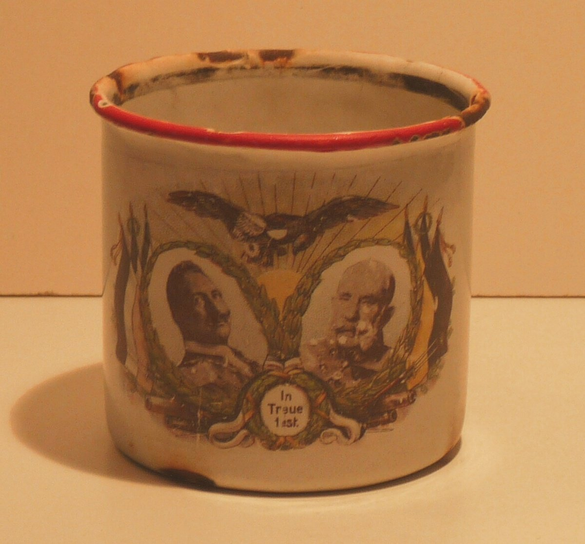 Metal cup with portrait of Franz Joseph I., Wilhelm II. and war decoration