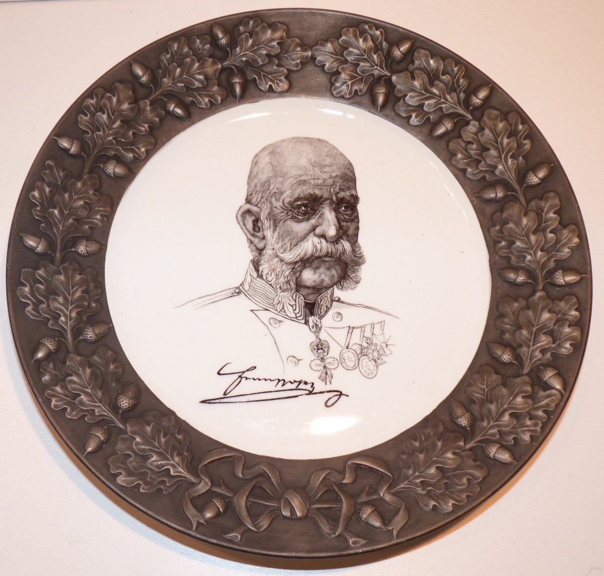 Plate with cartoons portrait of Franz Joseph I.