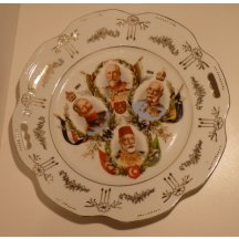 Plate with portraits of four european sovereign with gold decoration