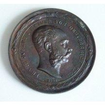 Bronzová medaile s císařovým portrétem