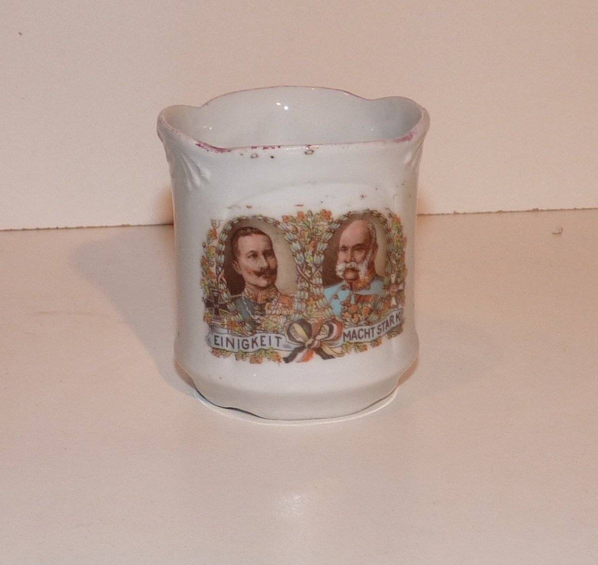 Little cup with portraits of two emperors , with flags