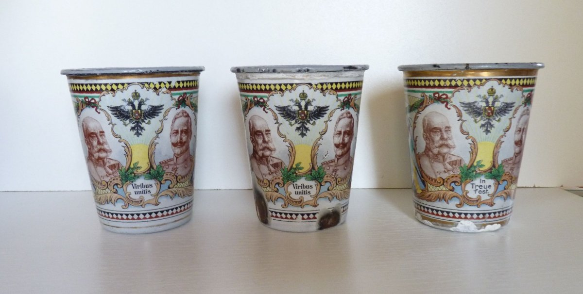 Set of three similar cups with portraits of the emperors