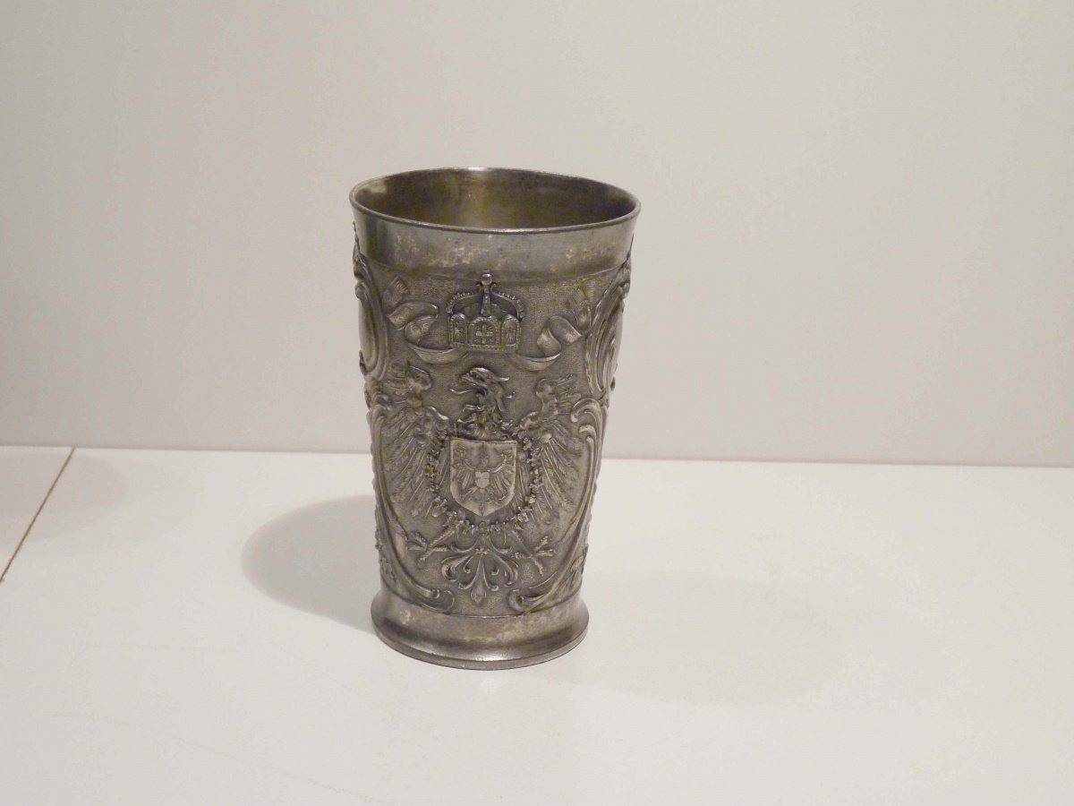 Austrian eagle and countrys symbols on tinny cup
